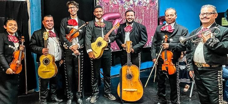 Mariachi Los Viajeros pose after a performance. - KM BRAMLETT