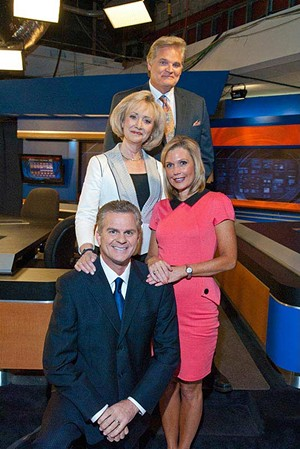 Top, Kevin Ogle, Linda Cavanaugh, Meg Alexander, and Lance West, form totem pole beside the anchor desk at News Channel 4.  mh