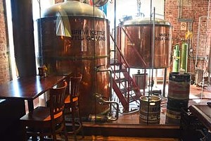 Brewing vesels behind glass at Bricktown Brewery.  mh