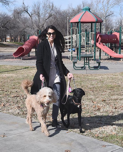 Emmery Frejo walking her two dogs, Molly and Olive, at Goodholm Park in the Jefferson Park Neighborhood of Oklahoma City, 1-5-16. - MARK HANCOCK