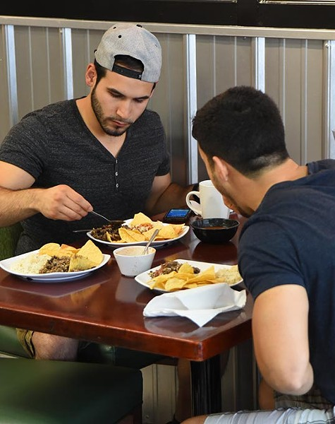 Two guys enjoy their lunch at Maya Latin Cuisine recently.  mh