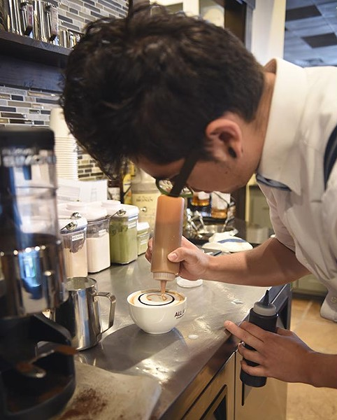 Jeremy Forquer creates a Carmal Macchiato at All About Cha, 13921 N. May Avenue.  mh
