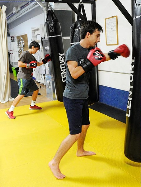Maxium Lujan, left, and Anton Barykin during a kickboxing class at Conan's Kick Boxing Karate Academy in Norman, Thursday, Jan. 7, 2015. - GARETT FISBECK