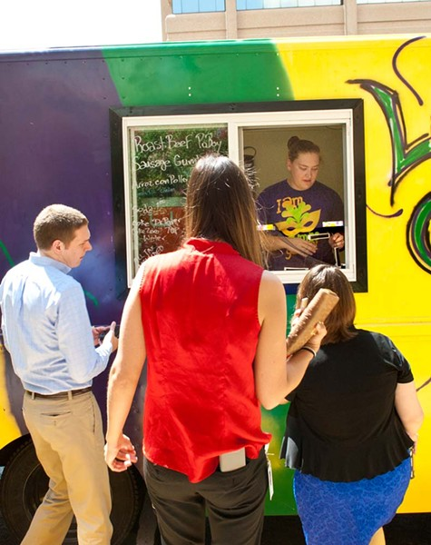 Rachel Fontanez works the window at the La Gumbo Ya Ya food truck, shown at corporate lunch event. (Mark Hancock)