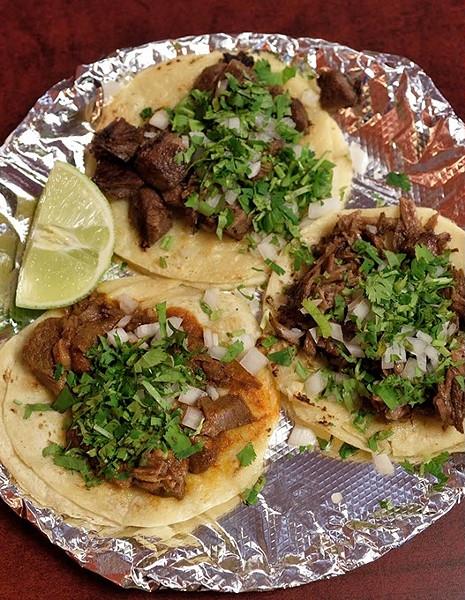Barbacoa, carnitas and lengua tacos at Taqueria la Tropicana, 12-21-15. - MARK HANCOCK