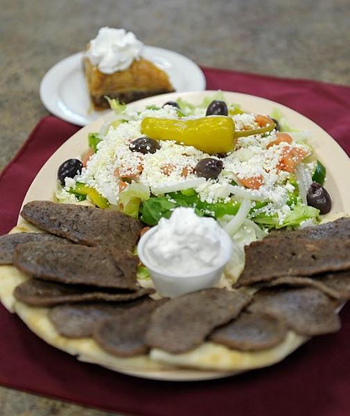 The gyro plate with greek salad and baklava at Dimitri's Peacock Greek in Oklahoma City, Wednesday, Nov. 19, 2014. - GARETT FISBECK