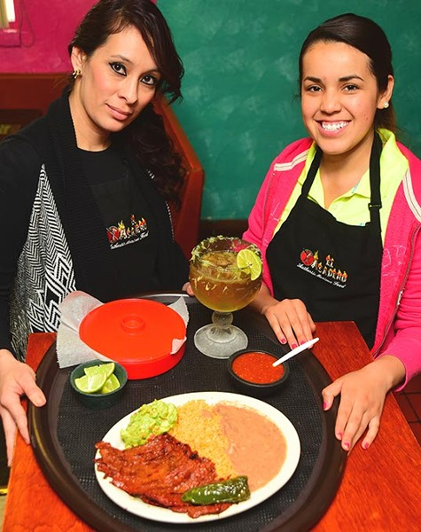 Left, Cesilia Marquez, and Maria Dolores, with Carne Asada, beans, rice, and beer, at El Asadero.  mh