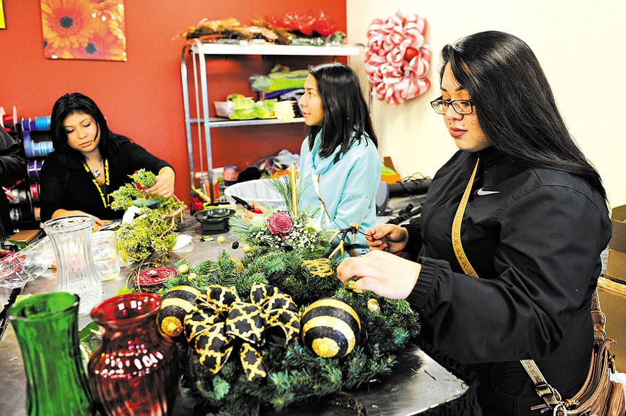 Yessica Oviedo, Jessica Rios, and Dalia Rios work in the horticulture class at Metro Career Academy in Oklahoma City, Friday, Dec. 11, 2015. - GARETT FISBECK