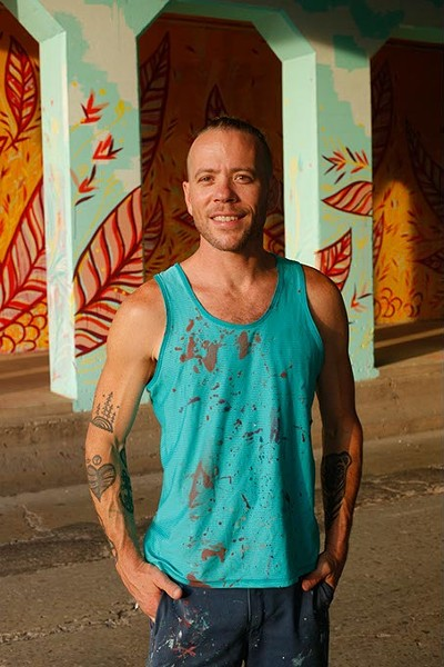 "Jason Pawley' poses for a photo at his ""Cultivation"" mural in Oklahoma City, Thursday, July 2, 2015. - GARETT FISBECK"