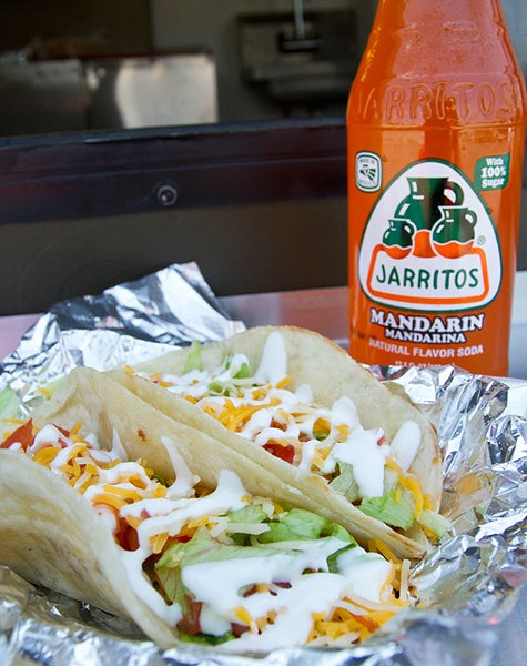Discada tacos (meat lovers tacos) being served with a mandarin jarritos at Juan More Tacos food truck in Moore, Saturday, July 25, 2015. - KEATON DRAPER