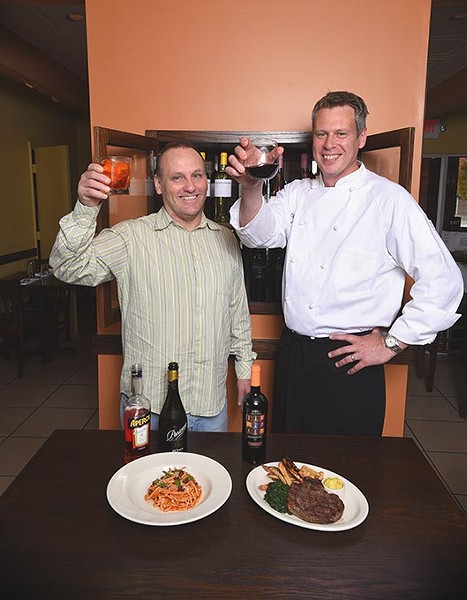 From left, Brian Cure, GM, and Robert DeCoste, Owner and Chef at Patrono, with drinks and two dishes, Bucatini Amatriciana pasta, left, and Steak Frites.  The Pinnacoli red wine is suggested by them to be a good pairing for both of these dishes, 11-10-15. - MARK HANCOCK