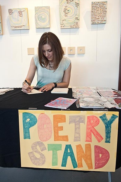 Kerri Shadid, Skirvin Hilton's Artist-in-Residence, writes a poem on the spot for visitors.  mh