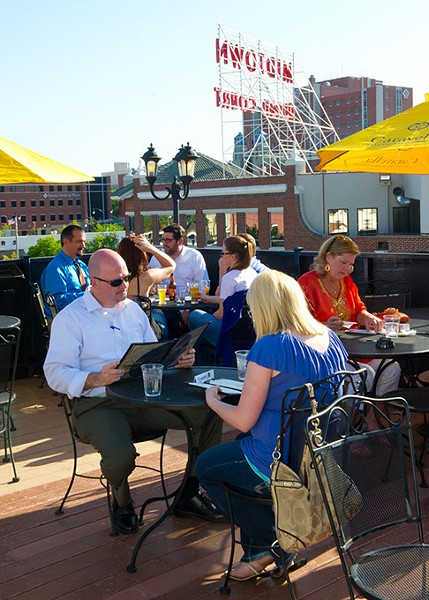 Patrons enjoy the outdoors with drinks and food on the rooftop at Cafe do Brasil.Photo/Shannon Cornman - SHANNON CORNMAN