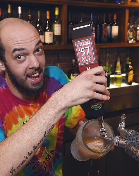 Bartender Brandon Whitehouse pulls a Hideaway 57 Ale, at Hideaway Pizza, 6616 N. Western Avenue in Oklahoma City. - MARK HANCOCK