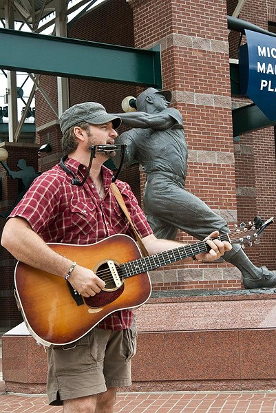 Out of the Box performer, Chad Slagle, plays near the Mickey Mantle statue at the Bricktown Ballpark, 7-19-14.  mh  mh