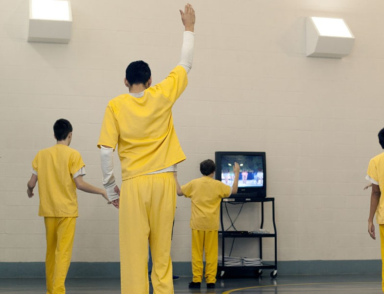 Juvinile inmates dance to a work out video at Canadian County Children's Justice Center in El Reno, Oklahoma. Photo by Lauren Hamilton - LAUREN HAMILTON