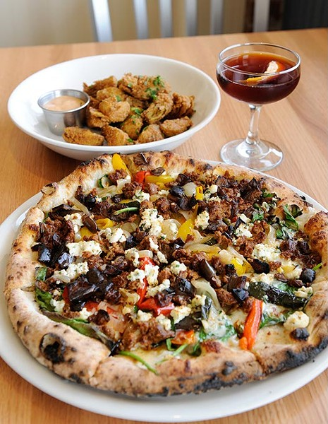 Lamb sausage pizza, fried artichoke hearts, and a Antiquato cocktail at Pizzeria Gusto in Oklahoma City, Wednesday, Jan. 28, 2015. - GARETT FISBECK