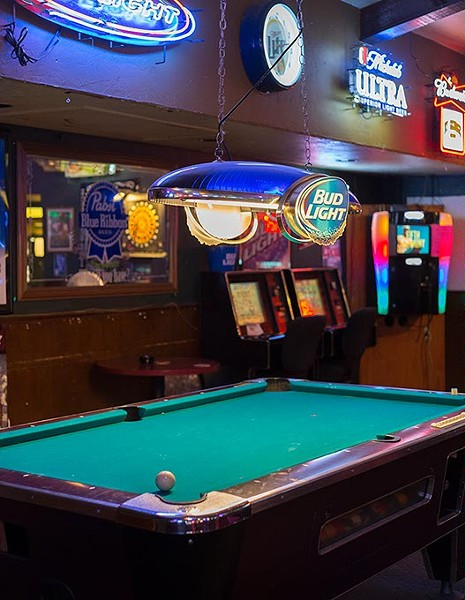 Cue ball sits on pool table at By George bar on Monday, July 7, 2016 in Oklahoma City. - EMMY VERDIN