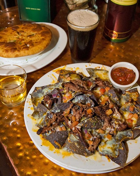 Pot Roast Nachos, up front, with a Chicken Pot Pie, shown with Irish Whiskey and Beer, at Blackbird Gastropub.  mh