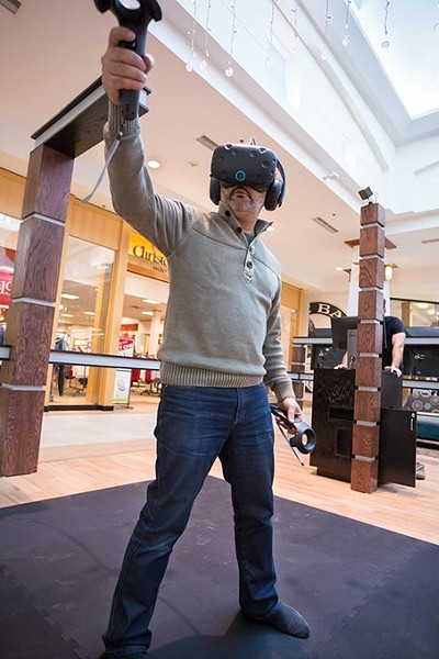Tarek Dina, co-owner of Immersion House Virtual Reality Store opening in Sooner Mall demonstrates Virtual Games on Tuesday, December 6, 2016 in Oklahoma City. - PHOTOS BY EMMY VERDIN