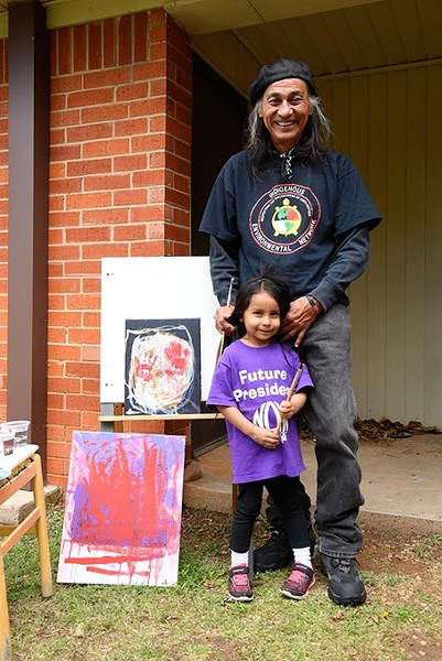 Richard Ray Whitman is teaching his 4-year-old granddaughter Seneca Pappan to paint. (Garett Fisbeck)