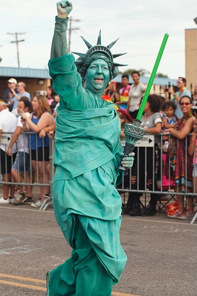 A participant dressed as Lady Liberty walks down 39th St. in the 30th Annual OKC Pride Parade on Sunday, June 25, 2017. (Cara Johnson).