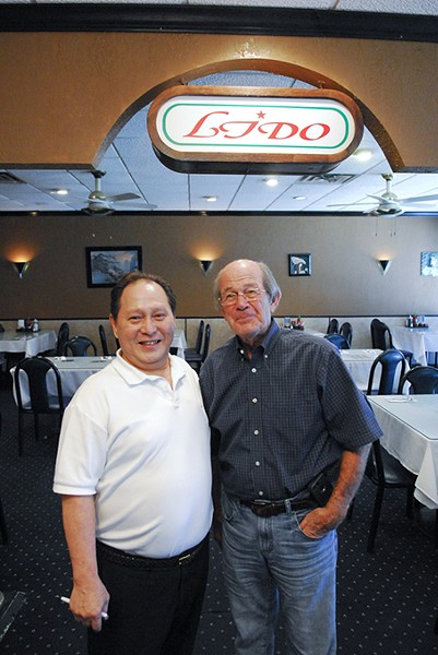 Paul Ly and one of their best customers, Phil Roberts.  mh