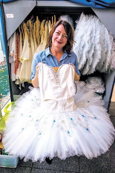 Dayna Brown goes through the Snowflake tutus used in Oklahoma City Ballet's The Nutcracker. | Photo Mark Hancock