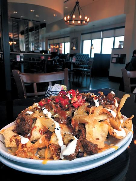 Using wonton chips and Korean-inspired skirt steak, fusion nachos are El Toro Chino's most popular dish.   Photo Jacob Threadgill