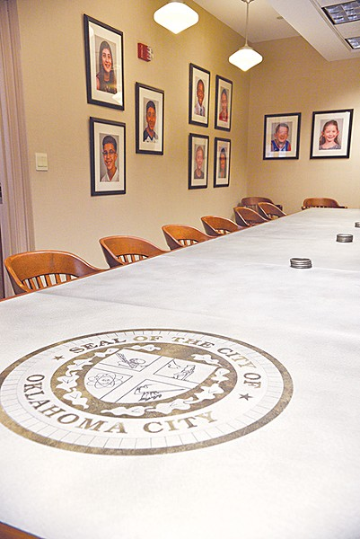 Inside the mayor's conference room at Oklahoma City Hall, Mayor David Holt directed city staff to hang photos of the city's children on the walls. Holt said he wants to remind leaders that they will make decisions that impact the next generation. - LAURA EASTES