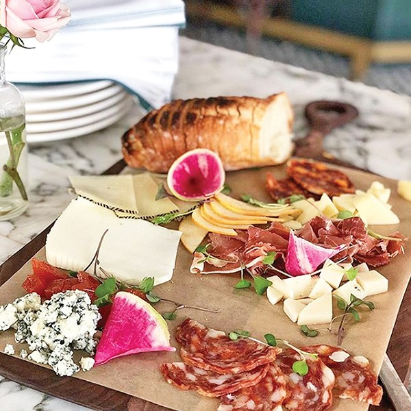A mixture of Spanish cheeses and meats on the Bar Arobolada cheese plate - PROVIDED