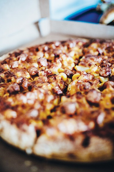 The Pi Pizzeria stand now serves a mac and cheese pizza topped with hot dogs. - ALEXA ACE