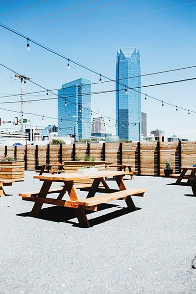 Angry Scotsman Brewing's expansive patio offers beautiful views of downtown Oklahoma City. - ALEXA ACE