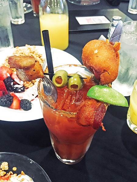 A bloody mary topped with a housemade corn dog, bacon and pork belly - JACOB THREADGILL