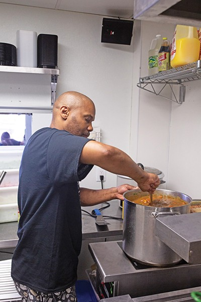 Dwayne Johnson stirs a pot of gumbo. - ALEXA ACE