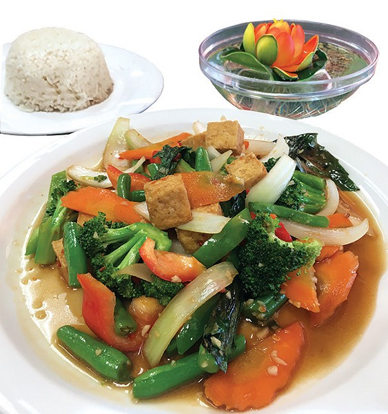 A lunch offering of vegetable stir-fry with tofu in Thai basil sauce - JACOB THREADGILL