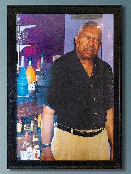 A portrait of Elmer's Uptown's founder Elmer Kemp hangs by the entrance. - PHILLIP DANNER