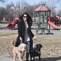 Emmery Frejo walking her two dogs, Molly and Olive, at Goodholm Park in the Jefferson Park Neighborhood of Oklahoma City, 1-5-16.