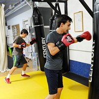 Maxium Lujan, left, and Anton Barykin during a kickboxing class at Conan's Kick Boxing Karate Academy in Norman, Thursday, Jan. 7, 2015.