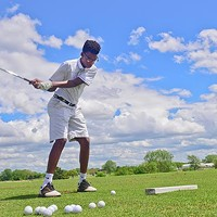 Cameron Shelton Jr. practices on some wedge shots during the First Tee session at the Douglass Park and James E. Stewart Golf Course.  mh