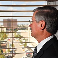 Judge Ray Elliott looks out of his office window in the Oklahoma County Courthouse towards the Oklahoma Coutny Jail, 9-16-15.