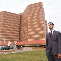 A graduate student in Harvard University's public policy program, Adam Luck, stands next to the Oklahoma County Jail, 10-8-15.