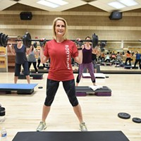 Michele Taylor, executive director for the Downtown, Mains Street, and MidTown YMCAs, lifts weights in a class at the Downtown YMCA, 1-7-16.