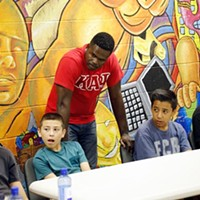 Sgt. T.G. Childs listens to members the FACT program during a lesson at Hathaway Recreation Center in Oklahoma City, Tuesday, Sept. 15, 2015.