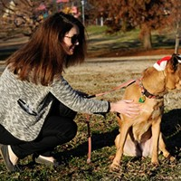 Allison Peterson walks Cabella at Flower Garden Park in Oklahoma City, Wednesday, Dec. 16, 2015.