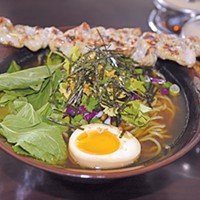 A Noodee bowl with ramen, grilled pork and pork broth.