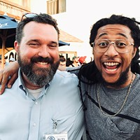 """New Health Solutions Oklahoma executive director Bud Scott left poses for a photo with local rapper and artist Mike """"Huckwheat"""" Huckeby right during the official Yes on 788 election night watch party at 51st Street Speakeasy."""