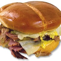 Cuban Boss sandwich with house-smoked ham, pulled pork, Swiss cheese, pickles and mustard sauce from Smoked Out BBQ