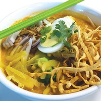 The special Khao Soi, a red curry-based soup with egg noodles, chicken and bok choy