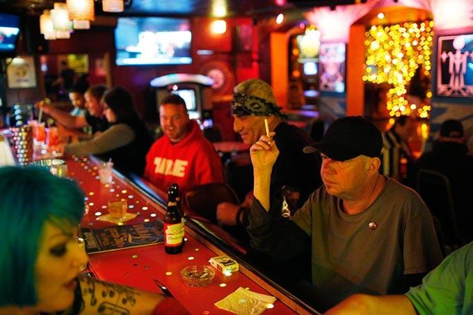 Patrons drink at the Hilo Club in Oklahoma City, Friday, Nov. 6, 2015. - GARETT FISBECK
